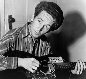 650px-Woody_Guthrie_2-300x276[1]