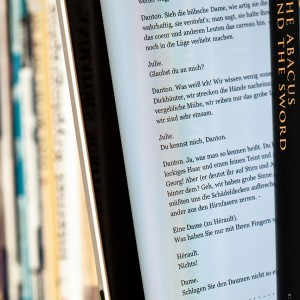 1280px-EBook_between_paper_books