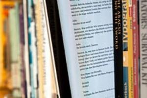 E-book-reader-between-print-books