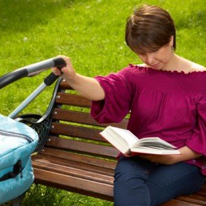mom-reading-book-baby-stroller