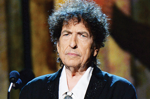 LOS ANGELES, CA - FEBRUARY 06: Bob Dylan speaks onstage at the 25th anniversary MusiCares 2015 Person Of The Year Gala honoring Bob Dylan at the Los Angeles Convention Center on February 6, 2015 in Los Angeles, California. The annual benefit raises critical funds for MusiCares' Emergency Financial Assistance and Addiction Recovery programs. For more information visit musicares.org. (Photo by Kevin Mazur/WireImage)
