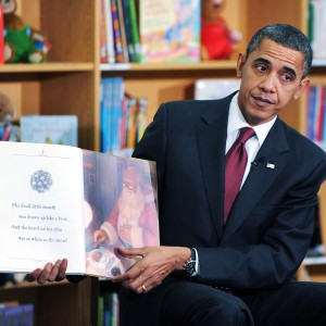ARLINGTON, VA - DECEMBER 17:  U.S. President Barack Obama reads a book to about 90 second graders at Long Branch Elementary School December 17, 2010 in Arlington, Virginia. Obama is expected to sign the compromise $858 billion tax legislation later in the day.   (Photo by Olivier Douliery-Pool/Getty Images)