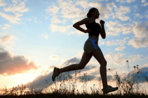 ist2_10060150-silhouette-woman-run-under-blue-sky-with-clouds1
