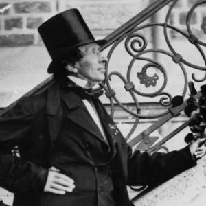 Hans Christian Andersen Posing Next to Stairway