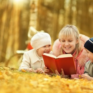 Mother reading book for children
