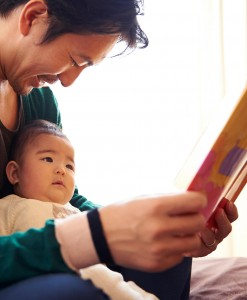 dad-reading-to-baby_950x1152