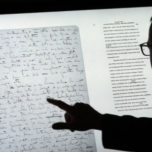 epa06054158 A man uses a touch screen to examine the manuscript 'The Trial' on a touch screen device and part of the exhibition 'Franz Kafka. The Whole Trial' in the Martin Gropius Bau, in Berlin, Germany, 28 June 2017. For the first time after it was written over 100 years ago the whole manuscript can be seen in Berlin. The idea for Kafka's famous work emerged from his conversation with his fiancee Felice Bauer about their engagement, something that the writer as a court session sensed.  EPA/FELIPE TRUEBA