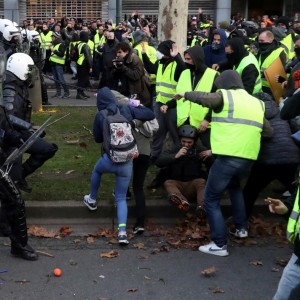 "Demonstrators clash with police during the ""yellow vests"" protest against higher fuel prices, in Brussels, Belgium, December 8, 2018. REUTERS/Yves Herman"