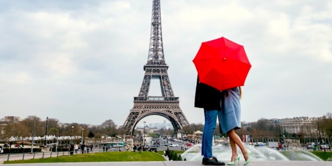 couple-kissing-behind-red-umbrella-paris-honeymoon-against-eiffel-tower-dreamstime-800-2x1
