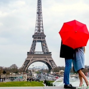 couple-kissing-behind-red-umbrella-paris-honeymoon-against-eiffel-tower-dreamstime-800-2x1