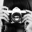 woman-holding-dslr-camera-in-grayscale-photography-3
