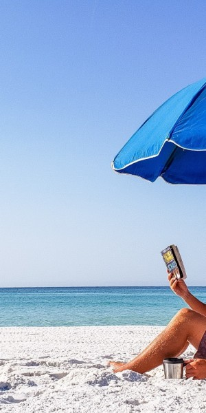 the-chairman-is-a-very-intellectual-guy-reading-a-paperback-book-under-his-beach-umbrella_t20_4lr2Ny