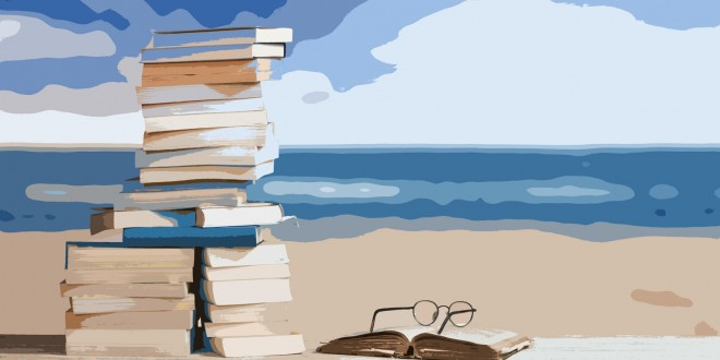 Stack of Travel Guides before a Beach